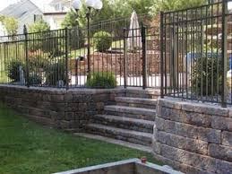 The Allan Block Blog Adding Fences Or Railings Above Retaining Walls