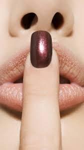 finger purple nailpolish lips