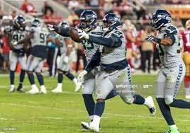 Seattle Seahawks defensive tackle Poona Ford takes a recovered fumble...  News Photo - Getty Images