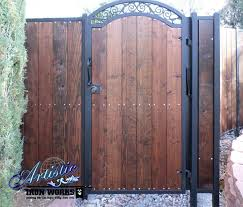 Fragrant Jasmine Panelling A Wrought Iron Fence Bordered By Brick And Adding Privacy Description From Pinterest Com Wood Gate Wrought Iron Fences Iron Fence
