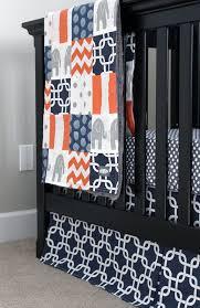 crib bedding navy blue orange and grey