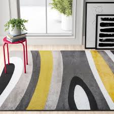warford abstract yellow gold area rug