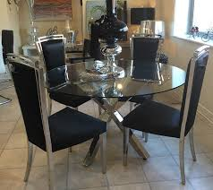 round chrome cross leg dining table