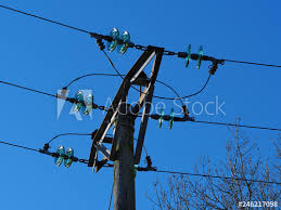 overhead electric power lines with blue