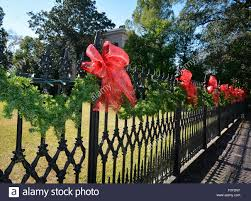 Red Ribbon Tied Around Black Wrought Iron Fence In Front Of Stock Photo Alamy