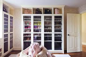 pink closet with glass door shoe and