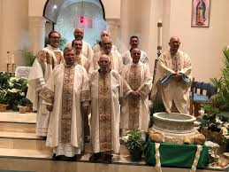 priests deacons and staff