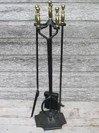 brass handled iron fireplace tools set