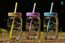 three mason jars with straws free image