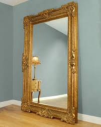 large gold framed leaner mirror