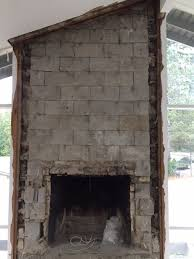 frame drywall around brick fireplace