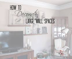 How To Decorate A Large Wall Designed Decor Family Room Walls Wall Decor Living Room Family Room Wall Decor
