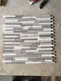 Wooden Grey Stone Mosaic Tile Wooden Vein Wooden Grain Chinese Wooden Tumble Irregualr Length Mix Volakas White Marble Mosaic Linear Strips Marble Mosaic For Wall Background Bathroom Floor Decoration From China Stonecontact Com