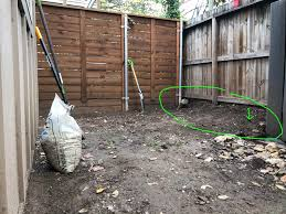 Can I Build A Retaining Wall Using Cinder Blocks Along This Fence To Fix The 1 Foot Sloping Ground Between Our Lots Landscaping