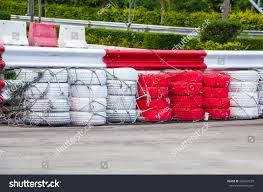 Racetrack Fence Red White Old Tires Stock Photo Edit Now 322947239