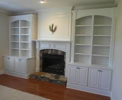 fireplace built ins with divided arched