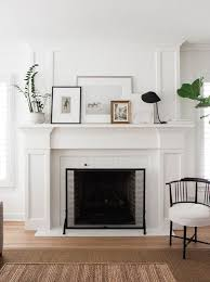 classic wood mantel painted white and
