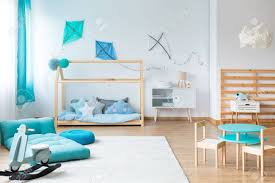 Modern Rocking Toy And Blue Mattress On White Carpet In Kids Stock Photo Picture And Royalty Free Image Image 85532027
