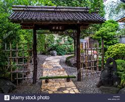 Entrance To Traditional Japanese Garden With Stone Path And Tile Stock Photo Alamy