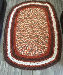oval area rag rug in burnt orange