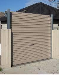 Freestanding Garage Door And Fence In 2020 Garage Door Rollers Roller Doors Garage Doors