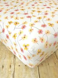 pink and yellow daisies crib sheet