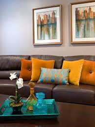 brown leather sofa with orange
