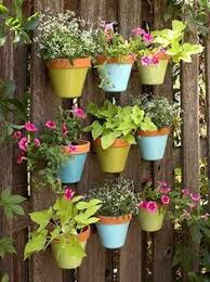 100 Vertical Small Space Garden Design With Flower Pots Ideas In 2020 Hanging Flower Pots Flower Pots Hanging Pots