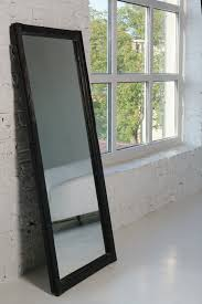 framed mirror beside big window