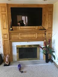 before fireplace remodel wood surround