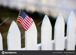 American Flag On White Picket Fence Stock Photo C Tueni2000 164802390