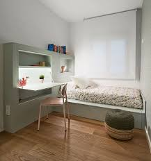 This Small Kids Bedroom Combines The Bed Frame A Desk And Shelves To Save Space