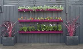 A Gutter Garden Made With Fence Planters Can Quickly Transform A Tired And Old Looking Fence Into A Bright Flo Gutter Garden Fence Planters Garden Planters Diy