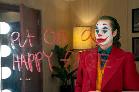 review joaquin phoenix is a vivid operatic joker but the movie