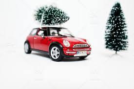car with a mini christmas tree