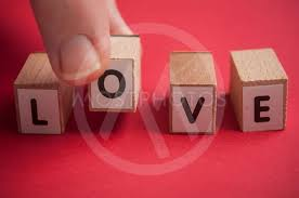 word love in wooden letter by