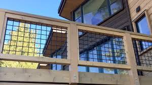 Black Wild Hog Panel Railing Installed Between Cedar Deck Rails Deck Railings Wire Deck Railing Deck Railing Diy