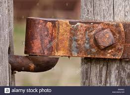 Rusty Old Gate Hinge On A Fence Post Stock Photo Alamy