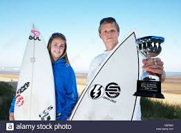 Welsh surfing champions Beth Mason and Adam Jenkins with their Stock Photo  - Alamy