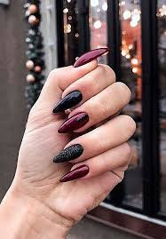mysterious black manicure is more