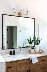 bathroom vanity with mixed metals in