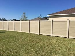 Horizontal Tan Wood Grain Vinyl Fence Mossy Oak Fence Company Orlando Melbourne Fl Vinyl Fence Fence Design Wood Grain Vinyl Fence