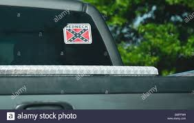 Close Up Of A Pick Up Trucks Rear Cab Window With Decal Sticker Of The Confederate Flag With Redneck Emblazoned With Bokeh Background In Rural Southe Stock Photo Alamy