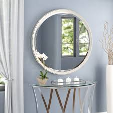 round silver beveled accent wall mirror