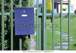 Mailbox Hanging On Fence On Blurred Stock Photo Edit Now 1098893375