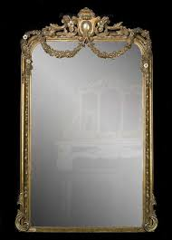 an antique french giltwood mirror