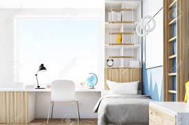 Side View Of A Kid S Room With A Bed A Bookcase And A Table Stock Photo Picture And Royalty Free Image Image 70978697