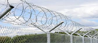 Concertina Wire Fencing Is Much Like Barbed Wire Fencing In The Sense That It Too Has Sharp Edges Fenceideas Fences Fenci Wire Fence Fence Concertina Wire