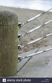 Tension Wire Fence And Wooden Post Stock Photo Alamy