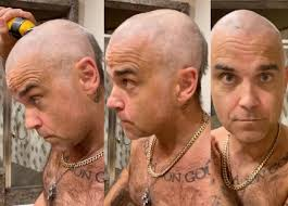 Robbie Williams shaves his hair in lockdown and does the reality ...